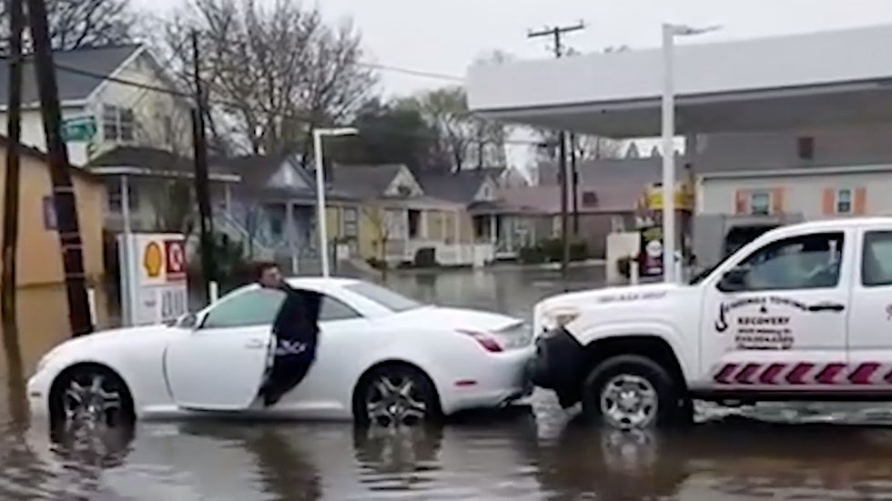 Charleston Flooding Traps Driver as Resident Reacts