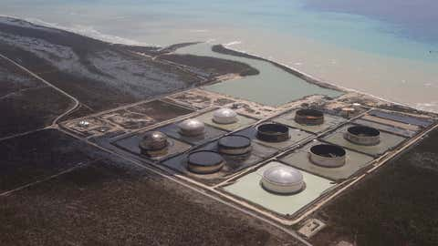 As Category 5 Hurricane Dorian battered the Bahamas, it blew the lids off of six massive crude oil tanks, seen above, causing a spill that may have reached the ocean. (Jim Abernethy)
