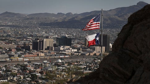 EL PASO, TX - JULY 18:  An Amerian and Texas flag are seen flying in front of the skyline of El Paso and Ciudad Juarez on July 18, 2018 in El Paso, Texas. A court-ordered July 26th deadline is approaching for the U.S. government to reunite as many as 2,551 migrant children ages 5 to 17 that had been seperated from their families.  (Photo by Joe Raedle/Getty Images)