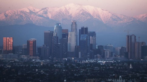 Snow-capped mountains stand behind the downtown skyline on February 11, 2019, in Los Angeles, California. (Mario Tama/Getty Images)