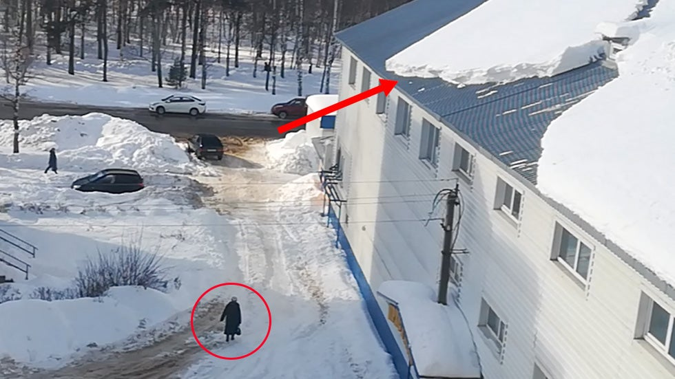 Russian Woman Nearly Crushed by Snow