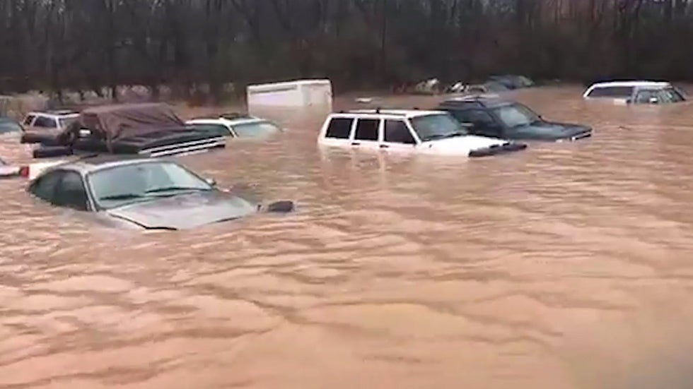 Floodwaters Surging Body Recovered Multiple Rescues Reported