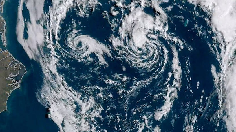 Twin Tropical Lows Create Face on Satellite
