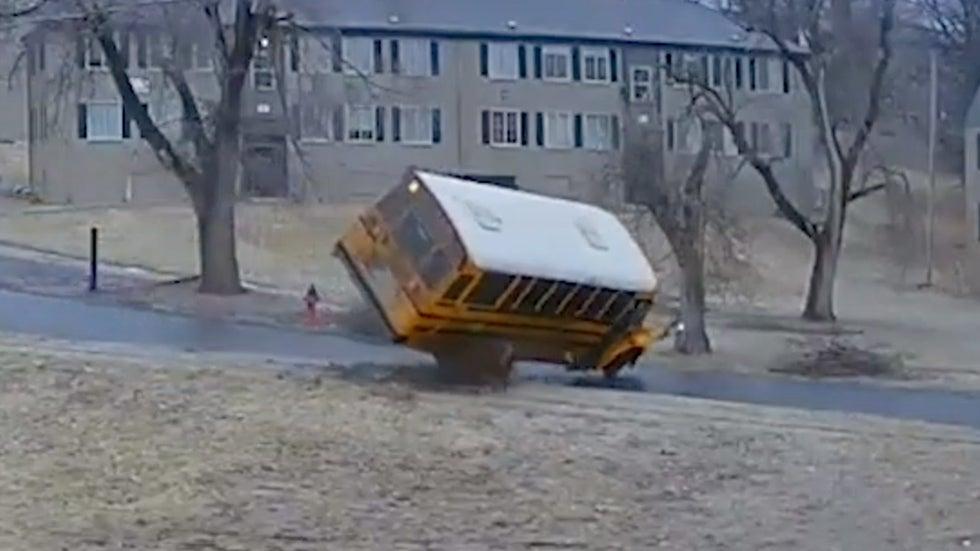 Watch School Bus Flip Over on Icy Road in Kansas City