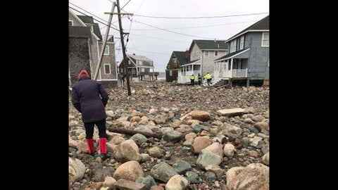 The roads in Scituate, Mass., are littered with debris on Saturday, March 3, 2018. (Peter Bonner)