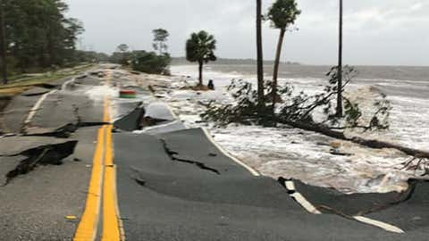 Chunks of U.S. 98 in Panama City Beach, Florida, were washed away by the storm surge from Hurricane Michael on Wednesday, October 10, 2018. (Photo by Charles Ferrell)