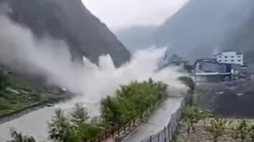 Giant Boulder Flung from Mountain Skips Across a River in China