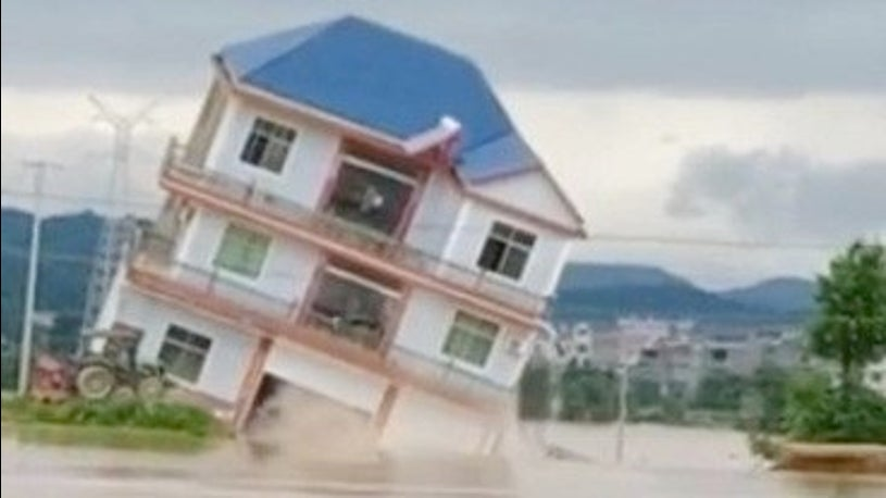 The Moment Three-Story Building Crashes Into Flooded River in China