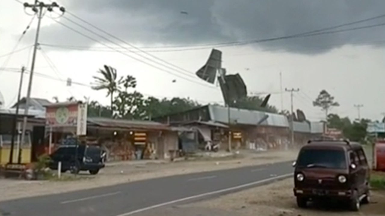 Watch Sparks Fly as Indonesia Tornado Sends Metal into Power Lines