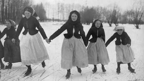 A family ice skating outside in Germany, circa 1900. (General Photographic Agency/Getty Images)