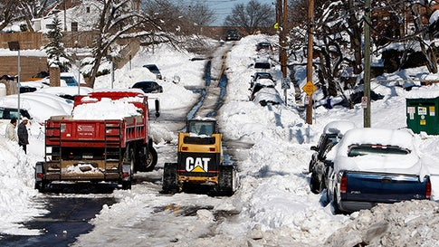 ARLINGTON, VA - FEBRUARY 08:  A road crew cleans up snow on a street February 8, 2010 in Alington, Virginia. The Washington area was hit by one of the biggest snowstorms in the history.  (Photo by Alex Wong/Getty Images)