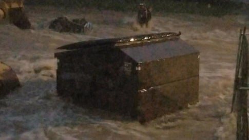 Iowa Floodwaters Carry Away a Dumpster