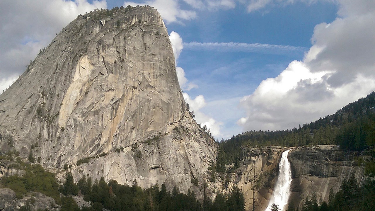 Water flows over the Nevada Fall near Liberty Cap as seen from the John Muir Trail in Yosemite National Park in California. The National Park Service says a man died after falling into a river at the park on Christmas Day. The park says an investigation into the death is taking longer than usual because of the partial government shutdown. (National Park Service via AP)