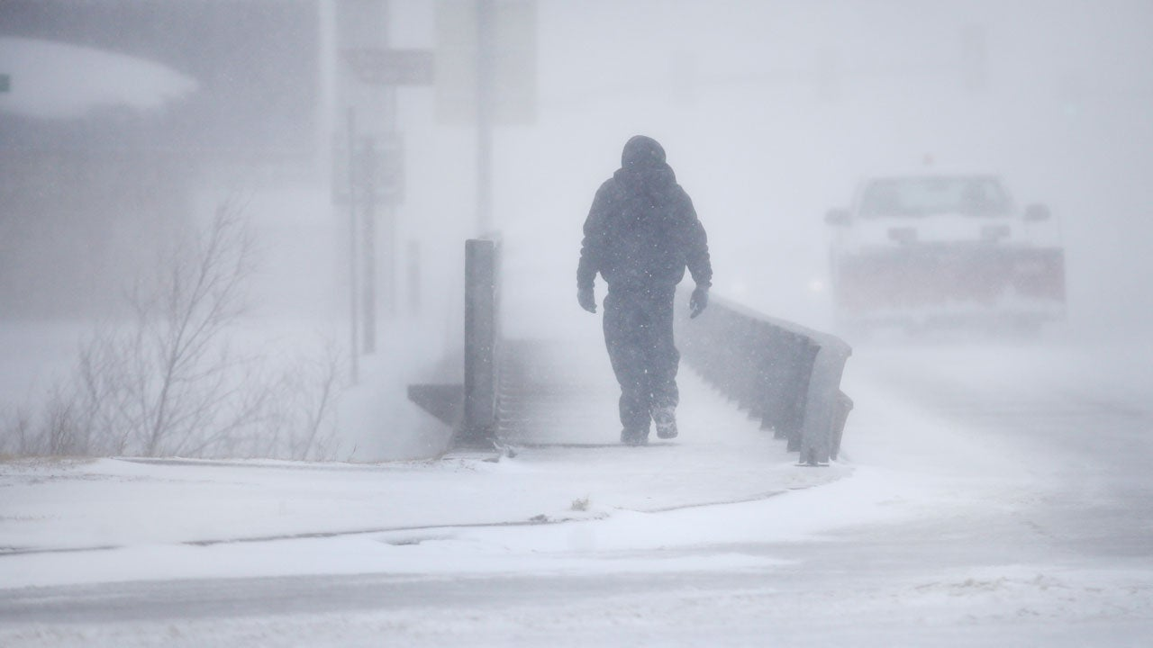 A man crosses Crow Creek during Winter Storm Ulmer on Wednesday March 13 2019 in Cheyenne Wyoming Jacob BykThe Wyoming Tribune Eagle via AP