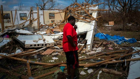 A man cries after discovering his shattered house and not knowing anything about his 8 relatives who lived in the house, missing in the aftermath of Hurricane Dorian, in High Rock, Grand Bahama, Bahamas, Thursday Sept. 5, 2019. (AP Photo/Ramon Espinosa)