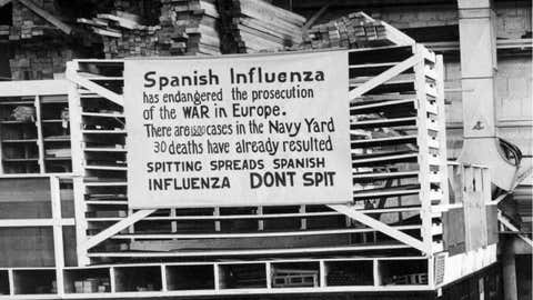 In this Oct. 19, 1918 photo provide by the U.S. Naval History and Heritage Command a sign is posted at the Naval Aircraft Factory in Philadelphia that indicates, the Spanish Influenza was then extremely active. The Mutter Museum will present a parade on Saturday Sept. 28, featuring about 500 members of the public, four illuminated floats and an original piece of music as a sort of moving memorial to the 1918-1919 influenza pandemic. (U.S. Naval History and Heritage Command via AP)