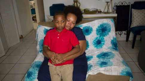 Kina Phillips holds her 5-year-old grandson Jamal Tillman, at their home in South Bay, Florida, on November 4, 2019. Phillips says Florida's annual sugar cane burning season is difficult for Tillman, whose immune system suffers and asthma worsens during burns. (AP Photo/Ellis Rua)
