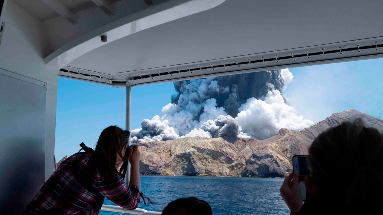 Nearly four dozen people were touring a volcano in New Zealand on Monday when it erupted.