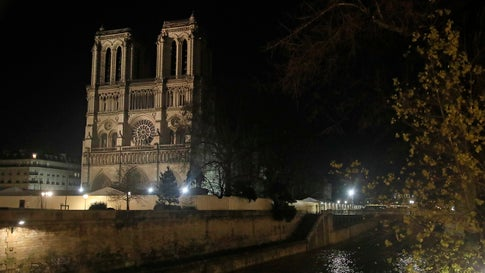 Notre Dame Cathedral is lit up in Paris on December 16, 2019. Last month, the Notre Dame Cathedral was illuminated for the first time since the fire in April. (AP Photo/Michel Euler)