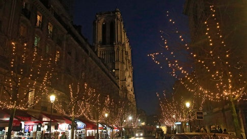 A street of shops is decorated with Christmas lights leading to the Notre Dame Cathedral in Paris on December 16, 2019. (AP Photo/Michel Euler)