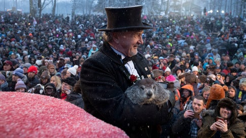 Groundhog Club co-handler John Griffiths holds Punxsutawney Phil, the weather prognosticating groundhog, during the 134th celebration of Groundhog Day on Gobbler's Knob in Punxsutawney, Pennsylvania, on Sunday, February 2, 2020. Phil's handlers sai the groundhog has forecast an early spring. (AP Photo/Barry Reeger)