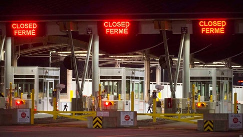 "The Canadian border is pictured at the Peace Arch Canada-U.S. border crossing in Surrey, British Columbia, Friday, March 20, 2020. New restrictions in effect at midnight Friday along Canada's shared border with the United States because of the coronavirus focus more on blocking tourists and bargain-hunters than on clearing the way for so-called ""essential"" travel such as truckers hauling freight, health professionals and others who live on one side and work on the other. (Jonathan Hayward/The Canadian Press via AP)"