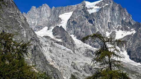 The Planpincieux glacier, located in the Alps on the Grande Jorasses peak of the Mont Blanc massif, is seen from Val Ferret, a popular hiking area on the south side of the Mont Blanc, near Courmayeur, northern Italy, Friday, Aug. 7, 2020. Some 70 people were evacuated Thursday in the valley below the glacier and roads closed after the threat of collapse the the fast-moving melting glacier is posing to the picturesque valley near the Alpine town of Courmayeur. (Claudio Furlan/LaPresse via AP)