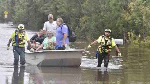 CORRECTS DATE TO SEPT. 17 NOT AUG. 17 Members of a citizen response team from Indiana assist in high water rescue of residents, Thursday, Sept. 17, 2020 in Pensacola, Fla. Homeowners and businesses along the soggy Gulf Coast have begun cleaning up in the wake of Hurricane Sally, even as the region braces for a delayed, second round of flooding in the coming days from rivers and creeks swollen by the storm's heavy rains. (Tony Giberson/Pensacola News Journal via AP)
