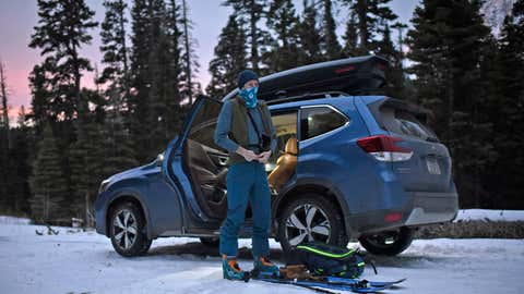 """Ben Werner, author of """"The Bozeman and Big Sky Backcountry Ski Guide,"""" prepares his gear to go backcountry skiing at dawn on Nov. 25, 2020, near Fairy Lake and Bozeman, Mont. Officials and experienced backcountry skiers are worried new restrictions at Montana ski areas could drive more inexperienced people into the backcountry this winter, increasing the risk of avalanche deaths. (Rachel Leathe/Bozeman Daily Chronicle via AP)"""