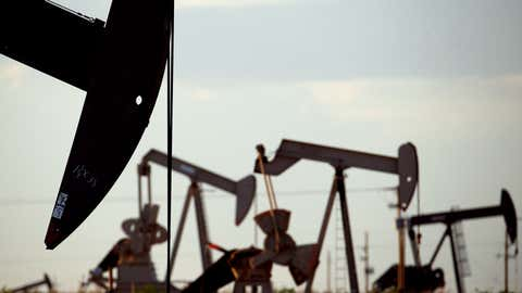 FILE - In this April 24, 2015 file photo, pumpjacks work in a field near Lovington, N.M. New Mexico Gov. Michelle Lujan Grisham, D-N.M. says nearly three-quarters of $1 billion could be lost over the next four years if New Mexico sees even a 10% reduction of oil and gas production due to President Joe Biden's actions to curb leasing on public lands. The first-term Democratic governor said Monday, March 15, in a letter to the president that financial losses of that magnitude would have real effects on the state's ability to achieve goals like universal access to early childhood education.  (AP Photo/Charlie Riedel, File)