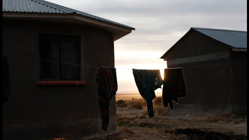 """Sweaters hang on a clothing line as the sun sets in in the Urus del Lago Poopo Indigenous community, in Punaca, Bolivia, Sunday, May 23, 2021. Since the lake dried up about five years ago, the Uru — """"people of the water"""" — are left clinging to its salt-crusted former shoreline scrabbling for ways to make a living. (AP Photo/Juan Karita)"""