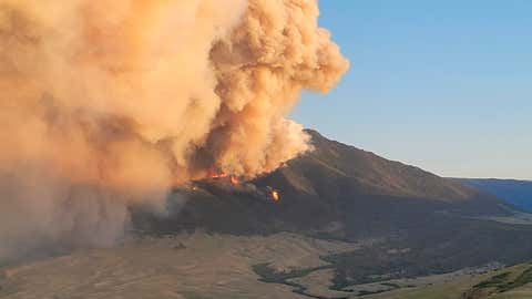 In this photo provided by the U.S. Forest Service, the Robertson Draw fire burns, Wednesday, June 16, 2021,  south of Red Lodge, Mont. The fire grew rapidly Tuesday amid a heat wave and gusting winds. (Amy Hyfield/U.S. Forest Service via AP)
