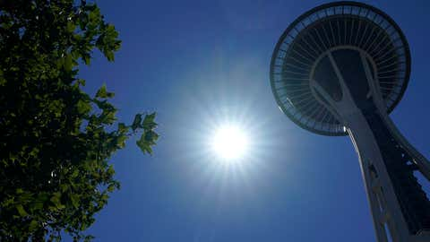 The sun shines near the Space Needle, Monday, June 28, 2021, in Seattle. Seattle and other cities broke all-time heat records over the weekend, with temperatures soaring well above 100 degrees Fahrenheit. (AP Photo/Ted S. Warren)
