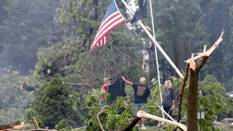 Jefferson County residents inspect damage at Dahnert Park, Thursday, July 29, 2021 in Concord, Wis., following an overnight storm. (John Hart/Wisconsin State Journal via AP)