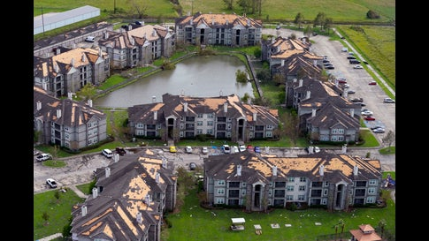 Roof damage is seen in the aftermath of Hurricane Ida, Monday, Aug. 30, 2021, in Houma, La. The weather died down shortly before dawn. (AP Photo/David J. Phillip)