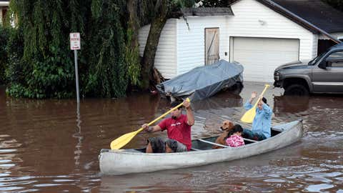 Residents canoe through floodwaters in the aftermath of Hurricane Ida in Manville, NJ, Thursday, Sept. 2, 2021. A stunned U.S. East Coast has woken up to a rising death toll, surging rivers and destruction after the remnants of Hurricane Ida walloped the region with record-breaking rain. (AP Photo/Carlos Gonzalez)