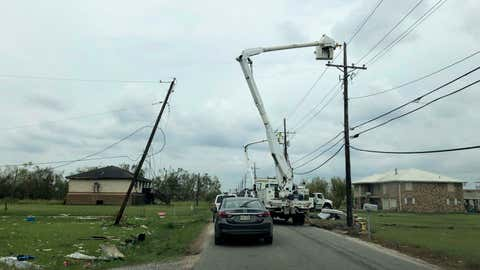 Utility crews work to restore power in rural Terrebonne Parish, La., on Wednesday, Sept. 8, 2021. Ten days after Hurricane Ida hit the state, many in southeast Louisiana remained without electricity. (AP Photo/Kevin McGill)