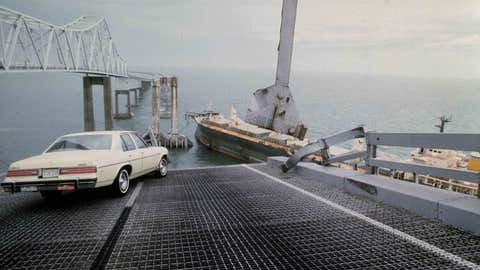 A car that was driven by Dick Hornbuckle is halted at the edge of the Sunshine Skyway Bridge across Tampa Bay, Fla.,  after the freighter Summit Venture struck the bridge during a thunderstorm and tore away a large part of the span, May 1980.  (AP Photo/Jackie Green)