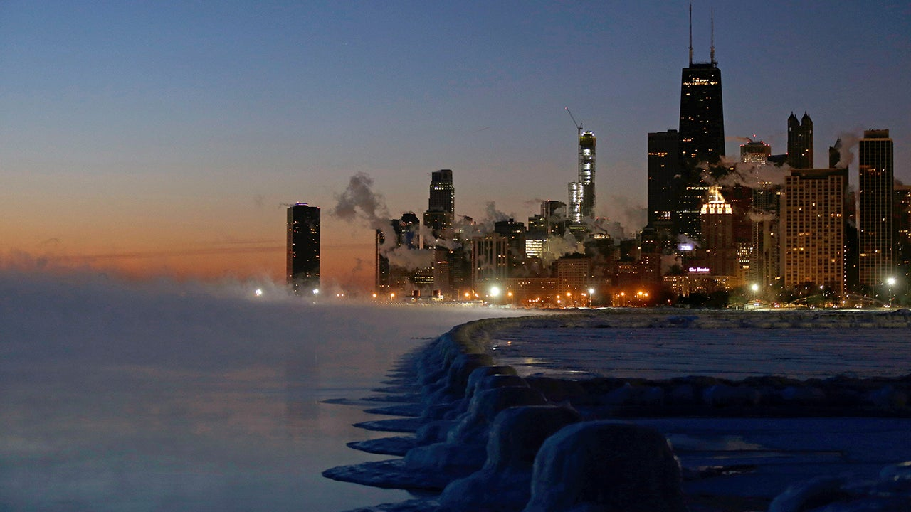 Ice forms along the shore of Lake Michigan before sunrise Thursday, January 31, 2019, in Chicago. The painfully cold weather system that put much of the Midwest into a historic deep freeze was expected to ease Thursday, though temperatures still tumbled to record lows in some places. (AP Photo/Kiichiro Sato)