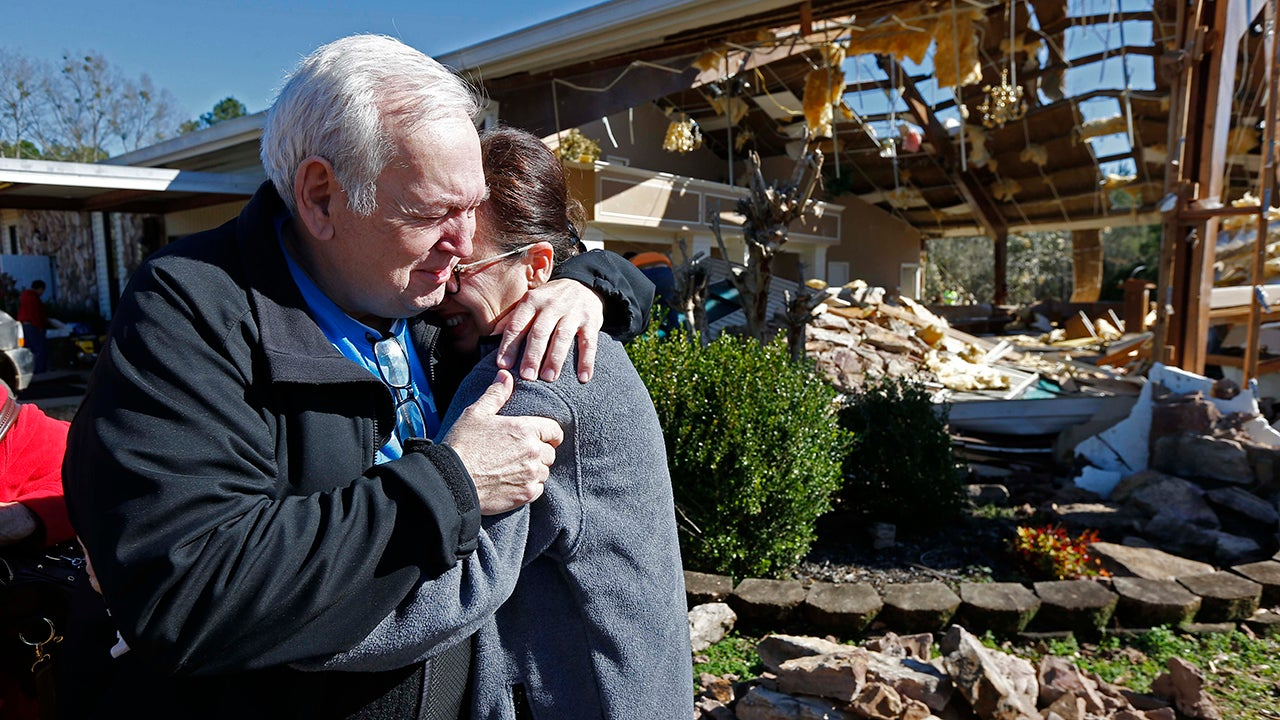 Pastor Steve Blaylock, left, comforts his wife Pat Blaylock, amid the rubble that was once the First Pentecostal Church in Columbus, Miss., Sunday morning, Feb. 24, 2019. A tornado Saturday wrecked havoc in the community, destroying a number of businesses as well as damaging and destroying homes. (AP Photo/Rogelio V. Solis)