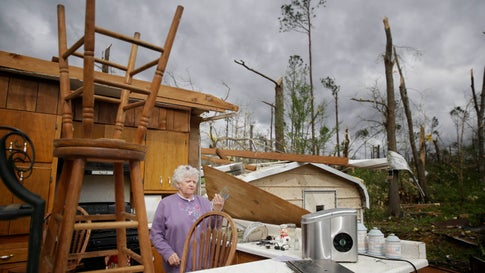 Emma Pritchett, 78, hold up a broken glass from her kitchen sink the day after a tornado hit on Monday, April 13, 2020, in Chatsworth, Ga. Severe weather has swept across the South, killing a multiple people and damaging hundreds of homes from Louisiana into the Appalachian Mountains. Many people spent part of the night early Monday sheltering in basements, closets and bathroom tubs as sirens wailed to warn of possible tornadoes. (AP Photo/Brynn Anderson)