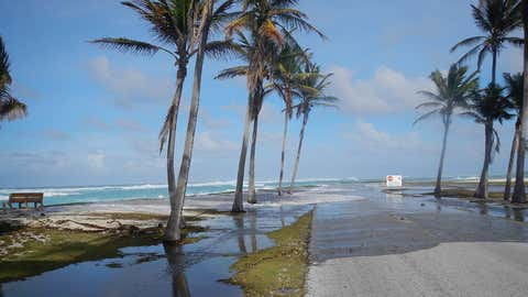Wave-driven flooding washes over a road on Roi-Namur atoll in the Marshall Islands (Peter Swarzenski/USGS)
