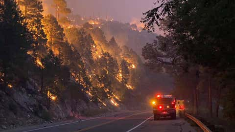 The Bighorn Fire burning in the hills north of Tucson, Arizona, has consumed more than 48 square miles. Evacuations were ordered in several communities. (Chris Ader/Three Points Fire District)