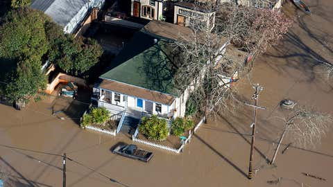 Flood waters from the Russian River partially submerge properties in Guerneville, California, on Thursday, February 28, 2019. The river in the wine country north of San Francisco reached its highest level in 25 years Wednesday night and Sonoma County officials say it won't return to its banks until late Thursday. (AP Photo/Josh Edelson)