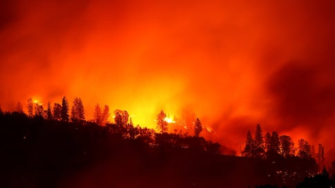 The Camp Fire, the deadliest and most destructive in California history, burns in the hills near Oroville, California, on November 11, 2018. The fire killed 85 people and burned 153,336 acres. (Justin Sullivan/Getty Images)