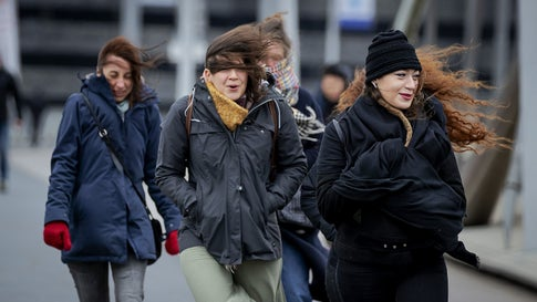 People walk against strong wind on the Erasmusbrug bridge, in Rotterdam, on February 9, 2020.  during the storm Ciara in Harlingen, The Netherlands, on February 9, 2020. - With howling winds and driving rain, forecasters said Ciara would also hit France, Belgium, the Netherlands, Switzerland and Germany. (Photo by Robin VAN LONKHUIJSEN / ANP / AFP) / Netherlands OUT - Belgium OUT (Photo by ROBIN VAN LONKHUIJSEN/ANP/AFP via Getty Images)