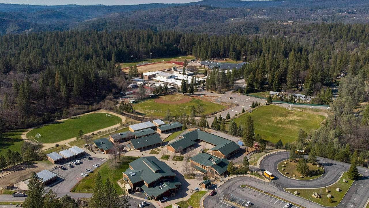 The elementary and high schools in Colfax, California, are surrounded by trees but they could become a safe zone in the event of a wildfire similar to the one that destroyed Paradise.  (Hector Amezcua/The Sacramento Bee via AP)