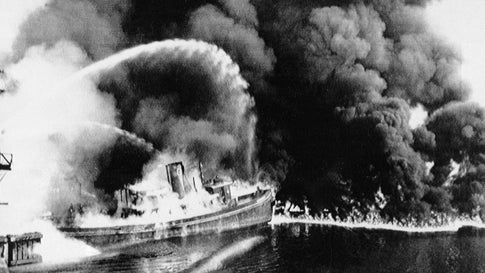 A fire tug fights flames on the Cuyahoga River near downtown Cleveland on June 25, 1952. Federal environmental regulators say fish living in the northeastern Ohio river are now safe to eat. (The Plain Dealer via AP)