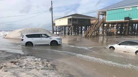 Sand and water surround vehicles on Tonty Court on Dauphin Island in Alabama as Hurricane Sally headed toward the Gulf Coast on Monday, September 14, 2020. (Facebook/Mayor Jeff Collier)