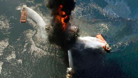 FILE - This April 21, 2010 file photo shows the Deepwater Horizon oil rig burning after an explosion in the Gulf of Mexico, off the southeast tip of Louisiana. Ten years after an oil rig explosion killed 11 workers and unleashed an environmental nightmare in the Gulf of Mexico, companies are drilling into deeper and deeper waters where the payoffs can be huge but the risks are greater than ever. (AP Photo/Gerald Herbert, File)
